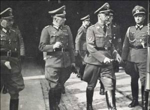 Werner von Braun is partially hidden, wearing his black SS uniform when Himler visits Peenamunde.